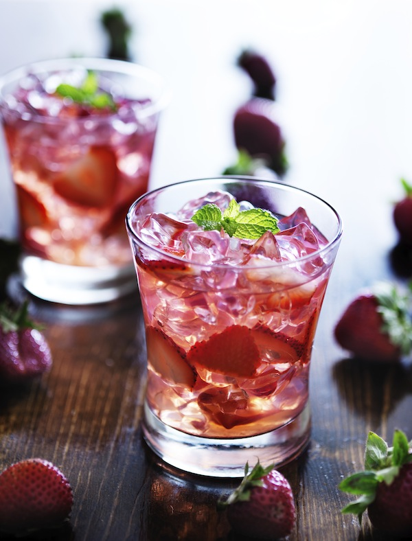 cocktail with strawberries, ice, and mint